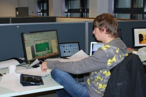 Jesse Venbrux (playing Spider Solitaire!) at YoYo Games